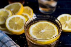 Refreshing Iced Tea with Lemon Rounds. A refreshing iced tea beverage with lemon rounds that's perfect to drink on those hot summer days royalty free stock images