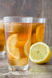 Refreshing iced tea with lemon on rustic wood Stock Photo
