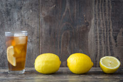 Refreshing iced tea with lemon on rustic wood Stock Image