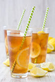Refreshing iced tea with lemon on white wood. Summer drink Stock Photography