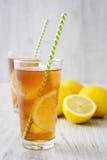 Refreshing iced tea with lemon on white wood. Summer drink Stock Image