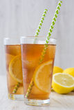 Refreshing iced tea with lemon on white wood. Summer drink Royalty Free Stock Photo