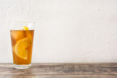 Refreshing iced tea with lemon on wood. Summer drink Royalty Free Stock Photo
