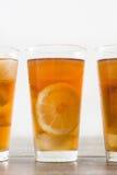 Refreshing iced tea with lemon on wood Royalty Free Stock Photography