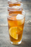 Refreshing iced tea with lemon on wood. Summer drink Royalty Free Stock Image