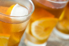 Refreshing iced tea with lemon on wood. Summer drink Stock Photography