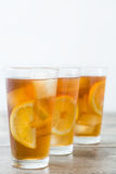Refreshing iced tea with lemon on wood. Summer drink Royalty Free Stock Photography