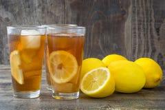 Refreshing iced tea with lemon on wood Stock Photo