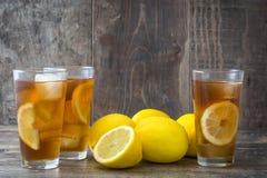 Refreshing iced tea with lemon on wood. Summer drink Stock Photo