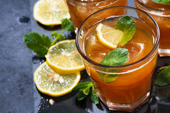Refreshing iced tea with mint and lemon, top view closeup Stock Image