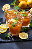 Refreshing iced tea with mint and lemon, vertical Stock Photo