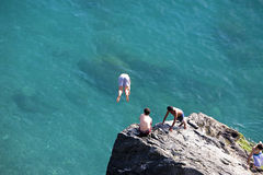 Refreshing images of boys enjoying the sea Royalty Free Stock Images