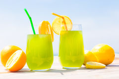 Refreshing juice on the sea Royalty Free Stock Photo