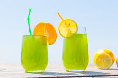 Refreshing juice on the sea Royalty Free Stock Image