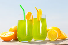 Refreshing juice on the sea Royalty Free Stock Photos
