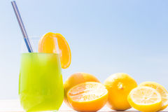 Refreshing juice on the sea Stock Images
