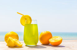 Refreshing juice on the sea Royalty Free Stock Photography