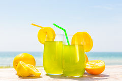 Refreshing juice on the sea Royalty Free Stock Images