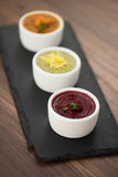 Refreshing lemon cranberry seabuckthorn sorbet. At white bowl royalty free stock images