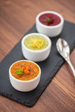 Refreshing lemon cranberry seabuckthorn sorbet. At white bowl stock photo