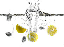 Refreshing Lemon And Ice Cubes Splashing Royalty Free Stock Photography