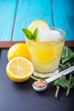 Refreshing lemonade with fresh citrus , mint and ice in glass Stock Image