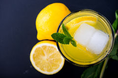 Refreshing lemonade with fresh citrus , mint and ice in glass Royalty Free Stock Photo