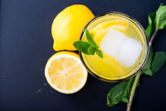 Refreshing lemonade with fresh citrus , mint and ice in glass Royalty Free Stock Images
