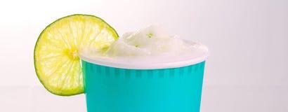 Refreshing lemonade, iced smoothie beverage. Refreshing lemon iced beverage with a lemon slice Stock Images