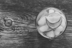 Refreshing lemonade with  lemon and ice closeup top view. Black and white photo Royalty Free Stock Images