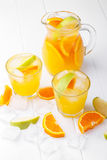 Refreshing lemonade with oranges and apple Royalty Free Stock Photos