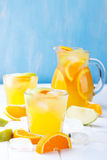 Refreshing lemonade with oranges and apple Royalty Free Stock Photography