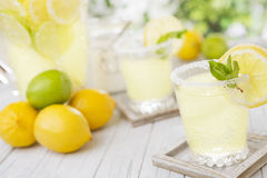 Refreshing lemonade on a rustic outdoor table Stock Photos