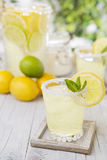 Refreshing lemonade on a rustic outdoor table Stock Photography
