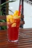 Refreshing lemonade on wooden table Stock Image