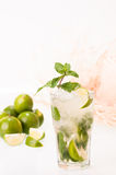 Refreshing Lime Mojito cocktail with a straw hat Stock Photo
