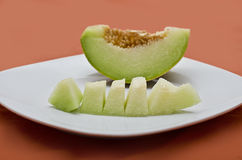 Refreshing melon. A bowl of refreshing melon on a platter, the best summer dessert royalty free stock photography