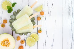Refreshing mexican style ice pops - raspberry, lime, honeydew margarita paletas - popsicles. Top view. Cinco de Mayo recipe. Refreshing mexican style ice pops