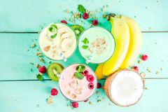 Refreshing milkshakes or smoothies. Summer refreshing drinks - protein shakes, milkshakes or smoothies, with fresh berry and fruits, light blue table copy space royalty free stock photo