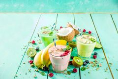 Refreshing milkshakes or smoothies. Summer refreshing drinks - protein shakes, milkshakes or smoothies, with fresh berry and fruits, light blue table copy space stock image