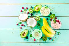 Refreshing milkshakes or smoothies. Summer refreshing drinks - protein shakes, milkshakes or smoothies, with fresh berry and fruits, light blue table copy space royalty free stock photos