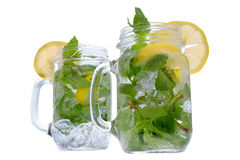 Refreshing mint and lemon drink in glass jars Royalty Free Stock Photos