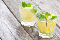 refreshing mint lemonade in glasses on a wooden background Royalty Free Stock Images