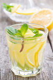 Refreshing mint lemonade on a wooden table, close-up Stock Images