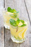 Refreshing mint lemonade on a wooden table Stock Photo