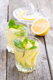 Refreshing mint lemonade on a wooden table, vertical Royalty Free Stock Photo