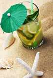 Refreshing mojito cocktail on the sea sand Royalty Free Stock Photo