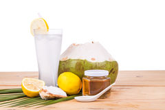 Refreshing natural green coconut with honey and lemon drinks Royalty Free Stock Image