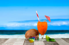Refreshing orange cocktail on beach table. Vacation at Paradise Royalty Free Stock Photo