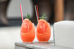 Refreshing orange coctail with grapefruit  on a table Royalty Free Stock Images